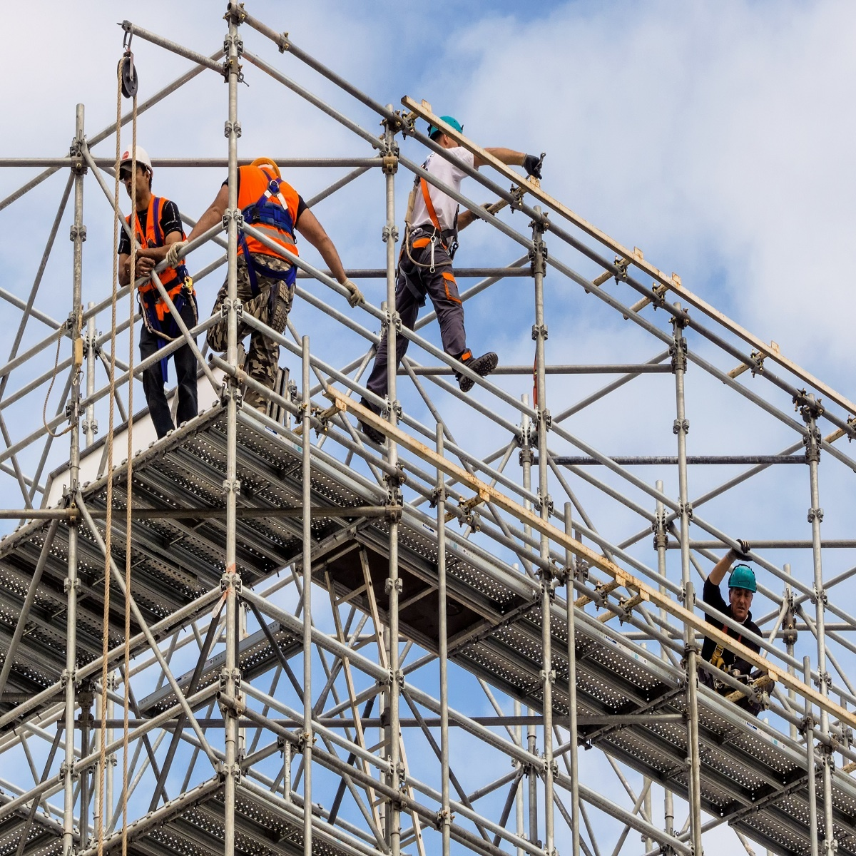 Workers Using Safety Procautions while on Scaffolding | Working at Heights: Getting Up