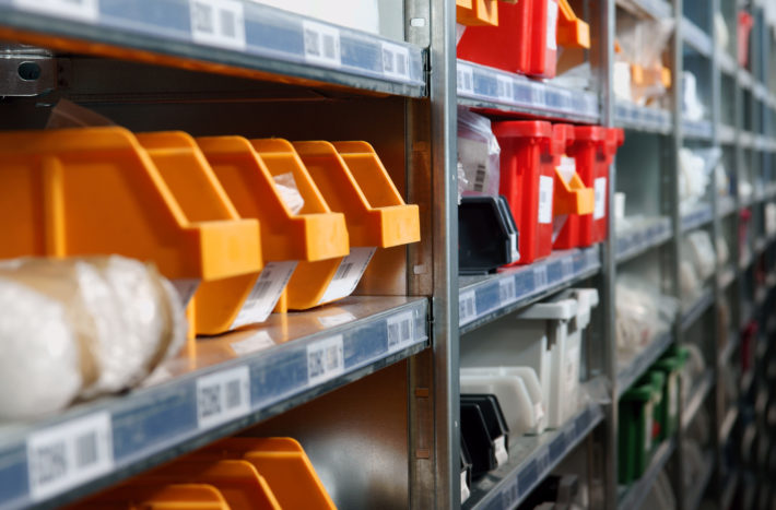 Storage bins and racks in a warehouse ideal for inventory management and stock concepts